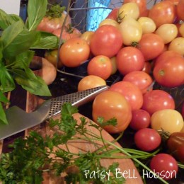 Cherry tomatoes and saladette tomatoes keep producing even when there the big tomatoes are center stage.